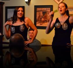 Guildenstern ogles the Murder of Gonzago dancers. (Bri Manente, Shaina Higgins) <em>Hamlet</em>
