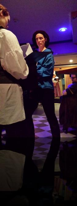 Sir Toby tries going vertical. Probably a bad plan. (Carolyn Kashner, Jessica Hansen) <em>Twelfth Night</em>. Photo by:&nbsp;Shakespeare in the Pub