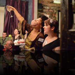 """Cheers!"" ""Yes dear."" (Mary Miller-Booker, Erica Smith) <em>Hanlet</em>. Photo by:&nbsp;<a href=""https://www.facebook.com/kevin.hollenbeck.77"" target=""_blank"">Kevin Hollenbeck</a>"