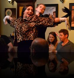 Rosencrantz and Guildenstern have the best view for The Murder of Gonzago dancers. (Katie Courlander, Scott Courlander, Shaina Higgins, Bri Manente) <em>Hamlet</em>