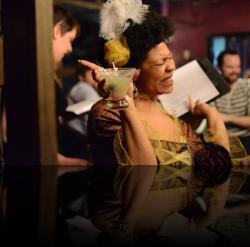 """Carousing is Gertrude's speciality. (Mary Miller-Booker) <em>Hanlet</em>. Photo by:&nbsp;<a href=""""https://www.facebook.com/kevin.hollenbeck.77"""" target=""""_blank"""">Kevin Hollenbeck</a>"""